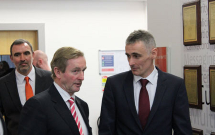 Avaya Lab Leader Tony McCormack introduces Taoiseach Enda Kenny to the Inventor Recognition Wall, also included on left is Avaya site leader in Galway Pat Lawless.