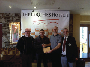 "Rob Fox Galway of WFC presents the €1,000 winning prize to Damien Fahy who was the ""Last Man Standing"" out of 920 participants who took part in the Last Man Standing Competition. Also in the photo is Sean Dunleavy (1st left) of the Arches Hotel, main sponsor for GWFC, and  Stephen Moran, chair of Galway WFC."