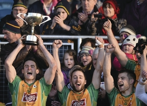 Michael Farragher, left, lifts the Shane McGettigan cup, as he celebrate's with team-mate's Michael Lundy, centre and Cathal Silke. Photo: Sportsfile