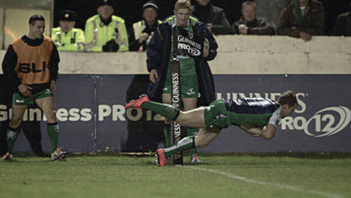 Side-line view: Connacht's Matt Healy, who is making a name for himself on the wing, scores the crucial try against Scarlets at the Sportsground, watched closed by Darragh Leader on the sideline.						Photo: Mike Shaughnessy