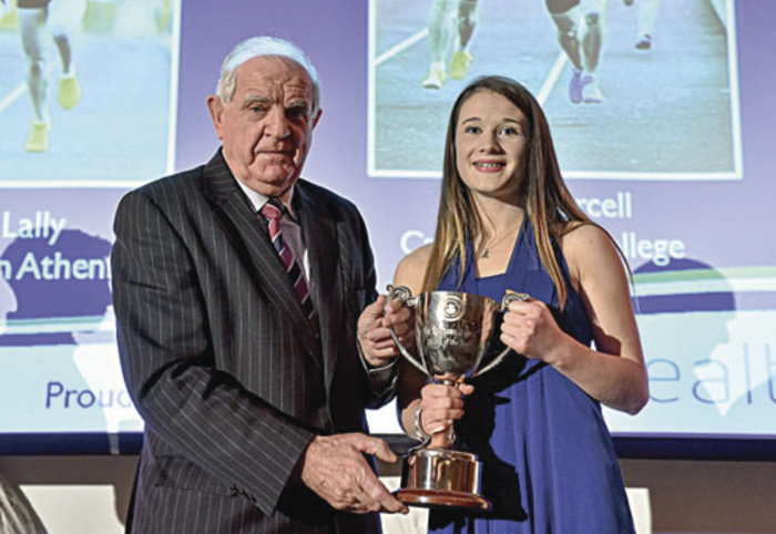 Allanah Lally, Presentation College Athenry, receives the Schools Girl Athelete of the Year award from Michael Hunt, president of the Irish Schools' Athletics Association, during the National Athletics Awards.  Picture: Barry Cregg / SPORTSFILE