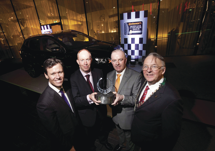 Nissan Qashqai wins 2015 Continental Irish Car of the Year. Pictured receiving the prestigious award is James McCarthy, CEO of Nissan Ireland with (l-r): Anton Savage, master of ceremonies; Tom Dennigan of Continental Tyres Ireland; and Austin Shinnors, chairman of the Irish Motoring Writers Assocaition.