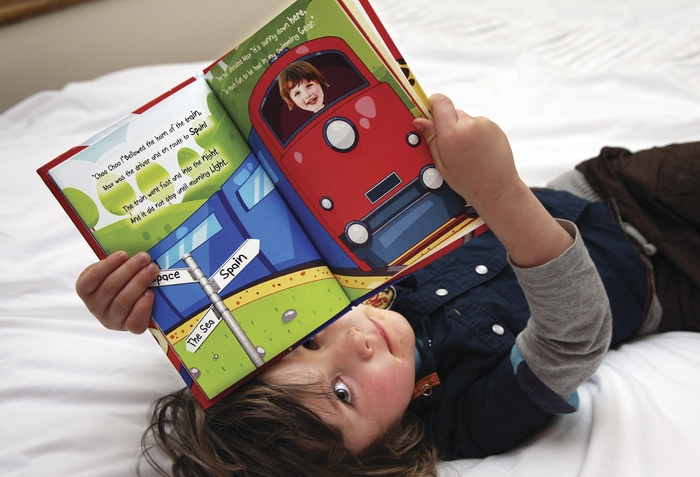 Eoin Heverin says his new story books are sure to encourage more children to develop a love for reading, just like his niece Lauren, pictured here enjoying her own personalised book.