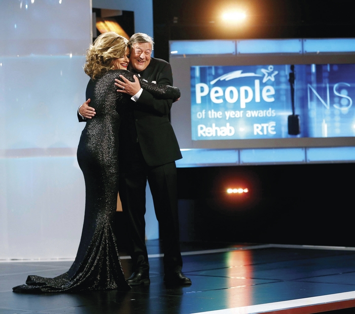 Rory O'Neill (AKA Panti Bliss) hugs Stephen Fry at the People of the Year awards.