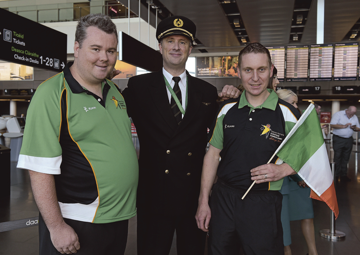 Martin Diskin pictured on right with his teammate Darach Flanagan and Aer Lingus captain Kevin Gaughan as he departed for the Special Olympics in Antwerp this autumn.
