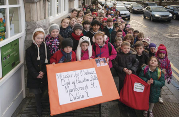 Christmas wish comes true: The children of Scoil Phadraig at Westport Post Office sending their Christmas letter to the Minister for Education. Photo: Michael McLaughlin.