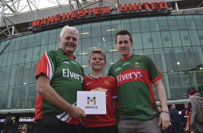 Lawrence Hennigan senior from Mayo Manchester and his son Lawrence junior with Cillian O'Connor at Old Trafford. Photo: Tony Hennigan.