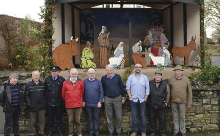 Photographed are members of Swinford Men's Shed in front of the giant Christmas crib.