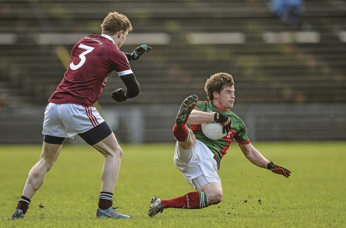Hard landing: Neil Douglas scored four points on his return to action for Mayo against NUIG. Photo:Sportsfile