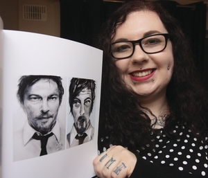 Galway artist Nicole Bartley with her portrait of Norman Reedus which is included in the actor's new book Thanks For All The Niceness. Photo:- Mike Shaughnessy.