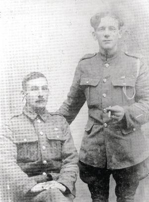 Private John Oliver of the Connaught Rangers (seated left) and his friend bandsman Tom Wall on leave together in their native Loughrea.