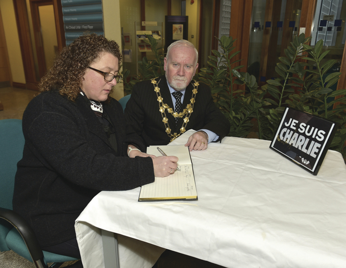 Galway City Mayor, Donal Lyons, and the French Consule Honoraire Catherine Gagneux sign the Book of Condolence Je Suis Charlie at Galway City Hall on Tuesday morning. 		Photo: Joe Travers