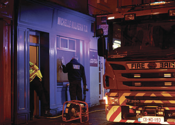 Gardai investigate the arson attack on the constituency office of Michelle Mulherin TD in Ballina on Tuesday night. Photo: Corinne Beattie Photography.