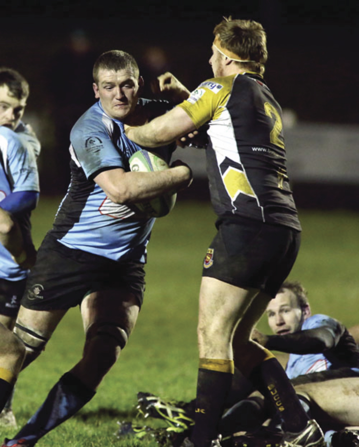 Marty Cummins of Galwegians is tackled by Buccaneer Shane Delahunt in the division 1B local derby clash at Crowley Park.