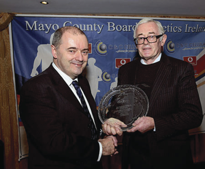 Paddy Kelly, Castlebar AC, is presented with the Hall of Fame award at the Mayo County Board of Athletics Ireland awards presentation in Hotel Westport, by Brendan Chambers of C&C Cellular (sponsor). Photo: Michael Donnelly.