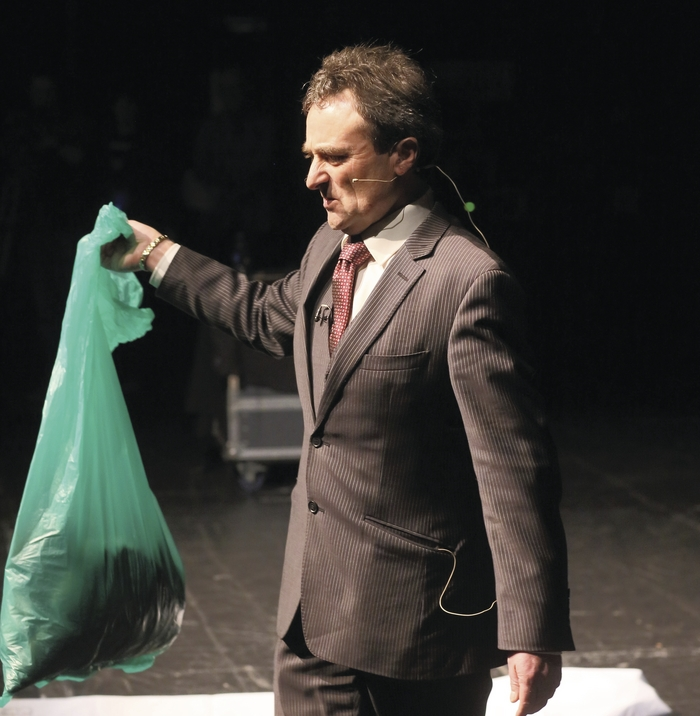 SHOCK TACTICS: Undertaker David McGowan, Ballina and Sligo, with a bag of a bag of personal belongings from a young female road crash victim as he spoke at the AXA Roadsafety Roadshow in conjunction with Mayo County Council at the Royal Theatre, Castlebar, on Thursday. Photo: Michael Donnelly.
