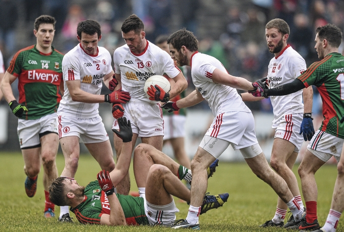Tough talking: Aidan O'Shea is surrounded by Tyrone defenders. Photo: Sportsfile