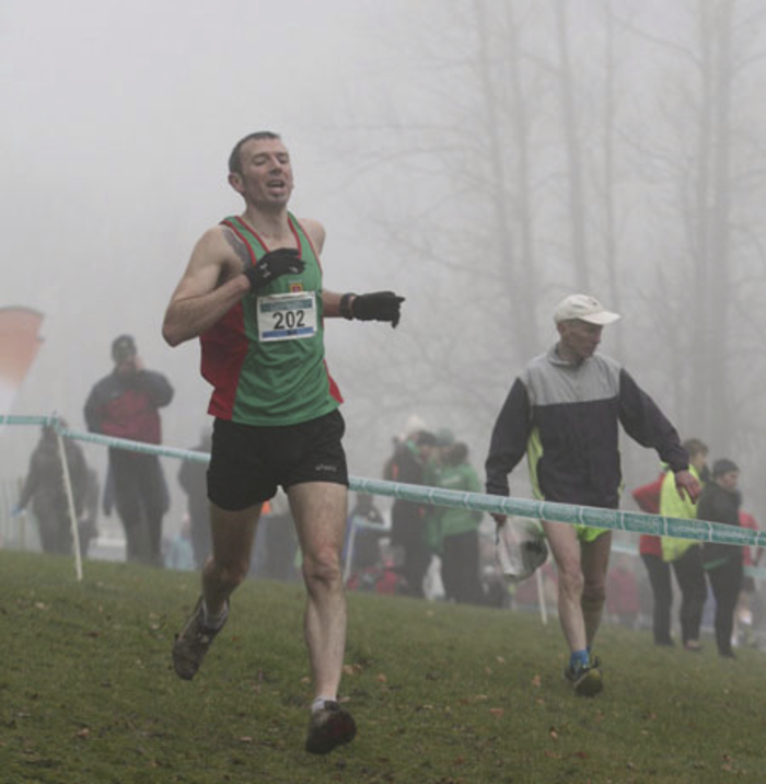 Fog runner: Mayo AC athlete Brendan Gill runs downhill through the fog at the National Intermediate and Masters Cross Country championships.
