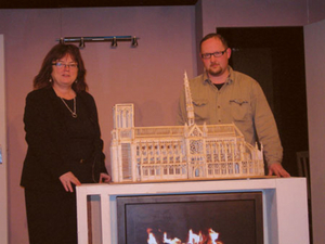 Caroline Coyle and Paul Breen, two members of the cast, together with a prop, a matchstick model of Notre Dame Cathedral made from over 150,000 matches