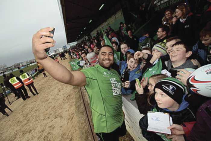 Connacht Rugby and Irish international Rodney Ah You poses with fans after the Irish Rugby squad trained with Connacht at the Sportsground on Wednesday morning.  Photo:-Mike Shaughnessy
