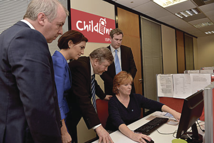 Pictured visiting the Childline unit were Brian Walsh TD, Senator Hildegarde Naughton, Dr James Reilly Minister for Children, Sean Kyne TD, with volunteer Mary Kilgarriff.