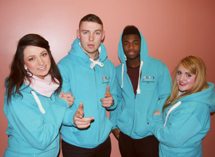Members of the Hairspray cast pictured in rehearsals: Jennifer Clogher (Tracy), Jack Quinn (Link), Sammy Rosney (Seaweed), and Caoimhe Crowe O'Connor (Penny)