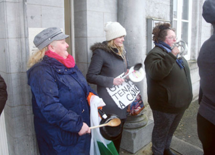 Joan Hannaway, Nicole Lonican, and Mags Glennon protesting outside County Buildings on Monday. Photo: Thomas Gibbons