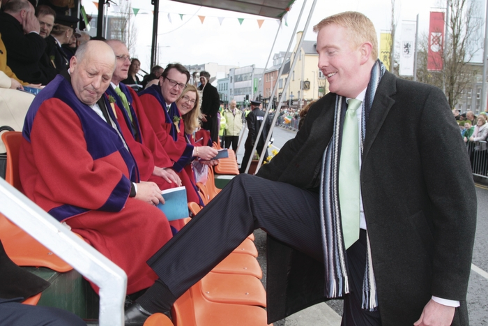 Dep Derek Nolan stepping into the viewing platform for the St Patrick's Day Parade in 2011.