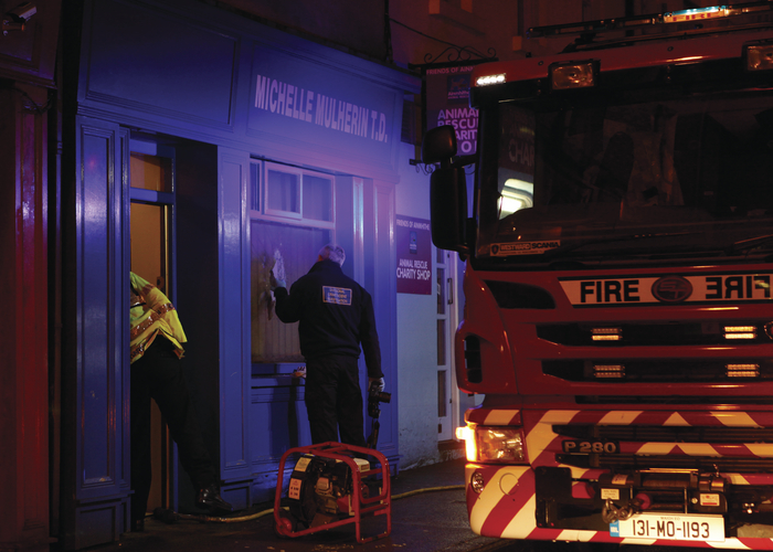 Gardaí and fire services at Deputy Mulherin's office last month. Photo: Corinne Beattie.