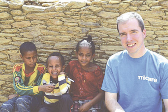 Fr Martin Whelan pictured with siblings of Mahlet, who is the face of the 2015 Trocaire Box.