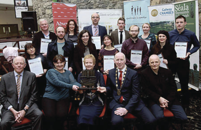 Back Row: Carol De Paor, Peter Murphy Electrical and Lighting, Patrick McCabe, Súil Nua Architecture Ltd, Mark Faherty, Faherty Paints, Meritta Gorman Geoghegan, Áil Rúin, Aisling Joyce, Joyce's Supermarket, Knocknacarra, Proinsias Ó Citt, CLG, Bhóthar na Trá-Cnoc na Cathrach,  Grace Light, Cope Galway, Lee Doherty, CARA Pharmacy & Beauty, Pádraig Murphy, iSupply, Aideen Connell, Claddagh and Celtic Jewellery, Andrea Tighe, Tí Tighe Fascinators 7 Fáiscín agus Cillín De Búrca, Brasserie on the Corner Front Row: Iggy Ó Muircheartaigh, Cathaoirleach Ghaillimh le Gaeilge, Bríd Ní Chonghóile, Ardfheidhmeannach Ghaillimh le Gaeilge,  Emer Ní Ógartaigh, Cairde Ghaillimh le Gaeilge, Leas-Mhéara Chathair na Gaillimhe, Cllr. John Walsh, and Declan Varley, Galway Advertiser (main sponsor of the Gradam)  in attendance at the press event in the Eyre Square Centre to announce Gearrliosta Ghradam Sheosaimh Uí Ógartaigh 2015.