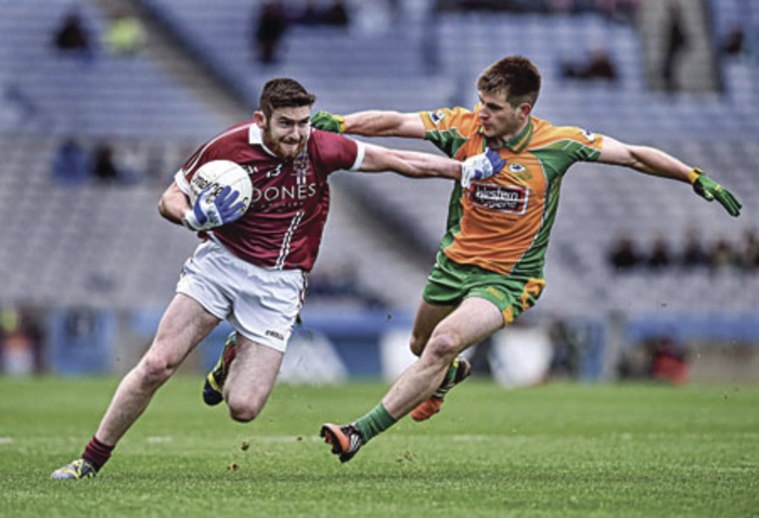 Cathal Silke (right), whose father is a selector with Galway and whose uncle, Ray,  was Corofin captain in 1998, chases down Gerald Brady of Slaughtneil In Tuesday's Croke Park final.