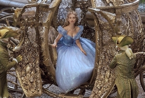 Lily James as Cinderella.