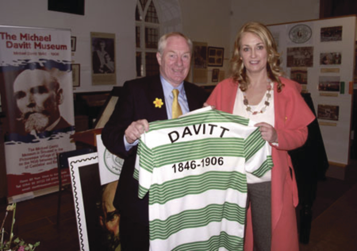 Yvonne Corcoran-Loftus presents a Celtic jersey to Minister of State Michael Ring at the official opening of a new exhibition on Davitt's links with the famous Scottish club.