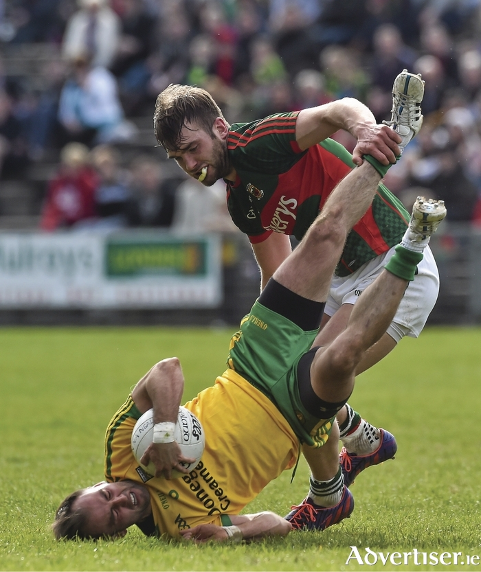 Upside down: Aidan O'Shea and Karl Lacey get things upside down. Photo:Sportsfile