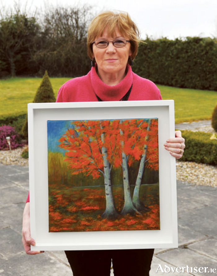 Ane Marie Kearns with her painting Autumn at Ladestown