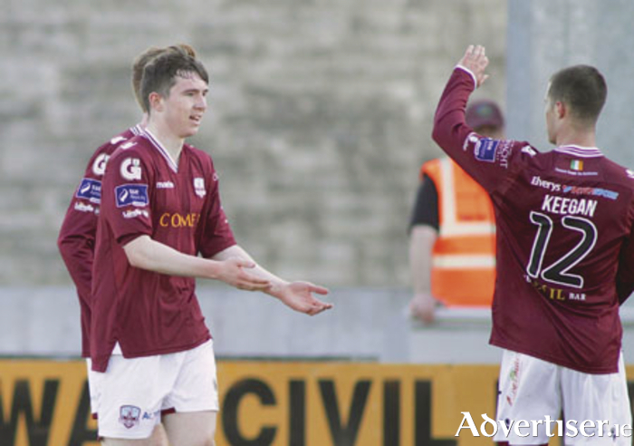 Galway United goal scorer Padraig Cunningham is congratulated by teammate Jake Keenan in action from the EA Sports Cup game against Cockhill Celtic at Eamonn Deacy Park on Monday. Photo:-Mike Shaughnessy