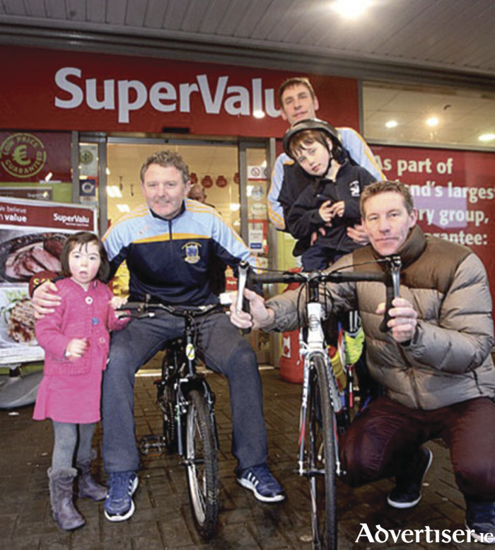 Former Galway Football manager, Alan Mulholland, and Nigel Forde of Nigel's Cycles will be cycling for Voices on April 6. Also pictured are Alison Burke(left), event PRO Brian Muldoon(rear), and Roan Muldoon on the bike.""