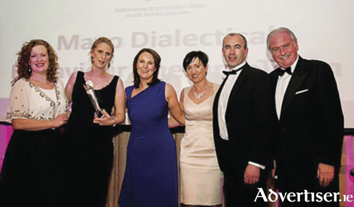 Receiving their award for Clinical Team of the Year 2015 at the Irish Healthcare Centre Awards were, from left: Deirdre Jordan, from the award sponsor Yakult, Rachael O'Reilly, Claire Lacey Quinn, Yvonne McCaffrey, Brendan Murphy, and awards presenter Marty Whelan.