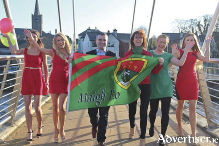 Models Emah Campbell, Mary Duff, Kathleen McGuire Jordan, and Magda Mazgaj with Deputy Dara Calleary and Deputy Michelle Mulherin on Ballina Bridge at the launch of Mayo Day. Photo courtesy of Mayo Manchester.