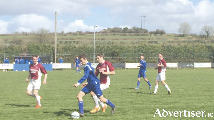 Pass the ball: Action from Sunday's Connacht Cup clash between Manulla and Corrib Celtic. Photo: CG