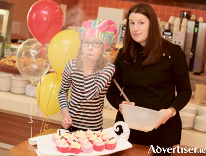 Tegan Foley, aged 10, pictured with Deirdre Bushell, marketing manager, Grovelands Childcare