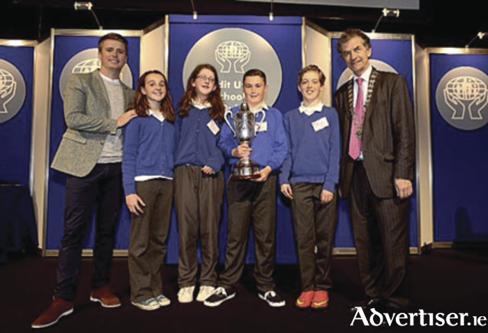 St Annin's winning quiz team, Roisin Duffy, Niamh Maguire, Padraig Faherty and Sam Dooher, with Brian Ormond and Martin Sysk, president of the Irish League of Credit Unions, after winning the Credit Union All-Ireland School Quiz on Sunday.