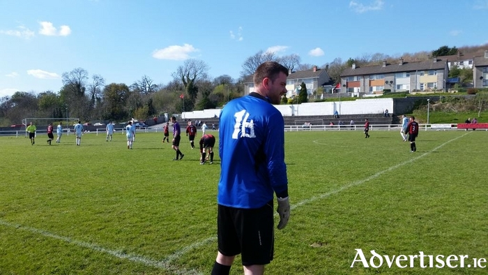 Taped up and ready to go: Westport United sub goalkeeper Micheál Gibbons has the number six taped on to his jersey before he is allowed to enter the action on Sunday. Photo: Westport United