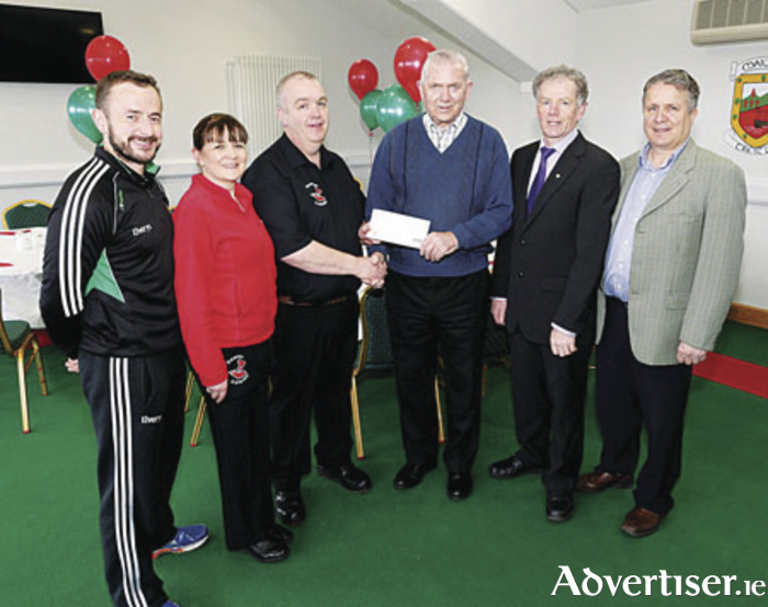 Margaret and Sean Julian of Treanlaur Catering sponsors of the Mayo GAA Senior Football Championship, presenting sponsorship cheque to JP Lambe, treasurer Mayo County Board; included are Aiden McLoughlin, PRO; Vincent Neary secretary and Mike Connolly, Chairman Mayo GAA County Board. Photo: Michael Donnelly