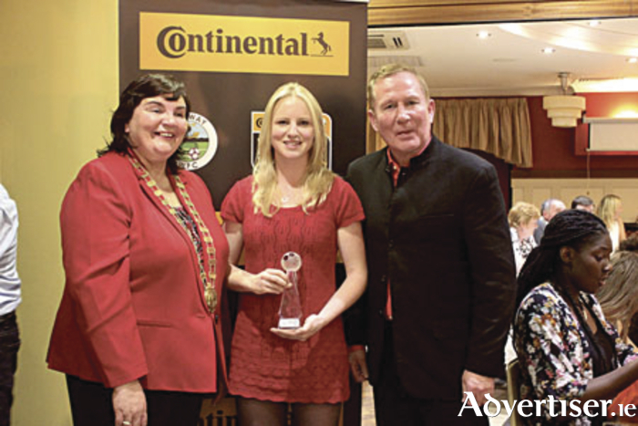 Cathaoirleach of Galway County Council, Mary Hoade; Ruth Fahy, Galway WFC Player of the Year; and Don O'Riordan, manager Galway WFC at the club's annual awards event.