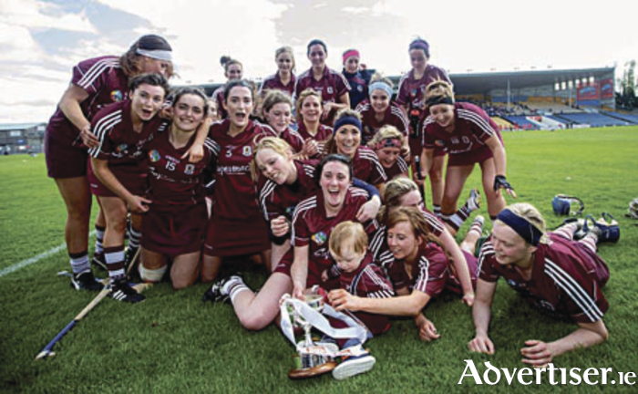 Galway return to the winning podium: The Galway senior camogie team celebrates victory  over Cork to claim  this year's Irish Daily Star Camogie League division one.