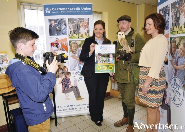 PHOTO COMPETITION: Pictured in Castlebar Credit Union at the launch of the Youth Nature Photo Competition in association with Bird Watch Youth was Jeremy Bolger, who is hoping to take a winning photo of Oisin the owl. Also in the picture are Majella Mulchrone, Castlebar Credit Union, Jason Deasy, falconer at Mount Falcon, and Eileen Bolger, Bird Watch Youth. For more information you can visit www.birdwatchyouth.com. Photo: Ken Wright.
