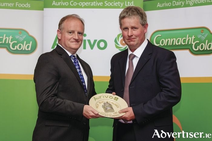 John Barrett collects his award at the Aurvivo Milk Quality Awards in Roscommon with Kevin Lane, Ornua CEO.