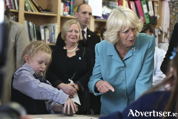 Her Royal Highness, Camilla, Duchess of Cornwall, speaking to pupils during her visit to a clay modelling demonstration at the Claddagh National School.